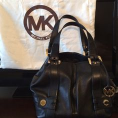 "Michael Kors GrabBag Shoulder Handbag Blk Leather Michael Kors Harness Grab Bag Shoulder Handbag Black Leather Rare and hard to find handbag. Pleated pebbled leather in black, Open top with side snaps creating a tote or grab bag. Double leather handles with 8"" drop. Gold tone hardware, Interior features zip pocket, and 4 slip pockets. Approximate Size: 10.5""H x 15""W x 6""D.  Does not come with dust bag, I do have the shopping bag if wanted can be included. See other listing for more photos…"