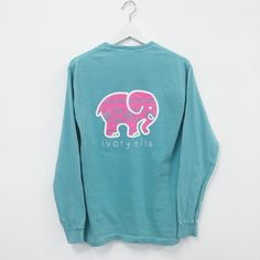 Pocketed Chalky Mint Neon Pink Aztec Print ($32) ❤ liked on Polyvore featuring tops, t-shirts, long sleeve shirts, sweaters, blue shirt, long sleeve pocket tee, long sleeve pocket t shirts, long sleeve tee and pocket tees