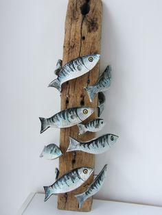 new work ! ceramic fish on driftwood post.