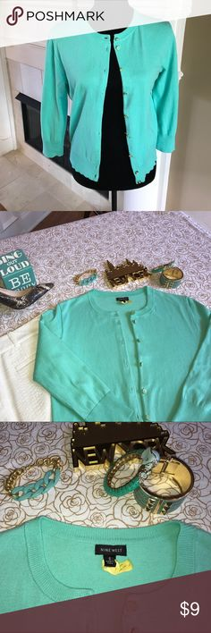 Nine West size Small Aqua Cardigan Nine West size Small 3/4 length sleeves Aqua Cardigan with beautiful aqua/gold buttons. Lightly worn. Machine washable but I always dry cleaned.  Super cute with white tee and jeans or over a sleeveless summer dress.    Purging my closet so keeping another similar item and turning this one loose for someone else to enjoy! Nine West Sweaters Cardigans