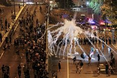 HONG KONG'S UMBRELLA REVOLUTION 9/2014  On Sunday evening, police began starting throwing tear-gas canisters into the crowd.