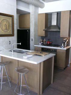 La cuisine ouverte de type « gagne-place » dans un petit logement de ville
