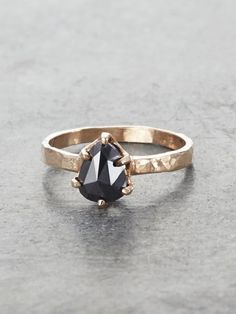 Like a forbidden fruit just within reach, the dark beauty of our Black Pear Diamond Ring will be sure to have you under its bewitching spell. The lush, ripe color of a 1ct. Black Rosecut Diamond is se
