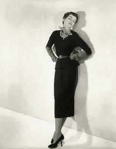Countess Maxime de la Falaise modeling a long, narrow black sweater dress