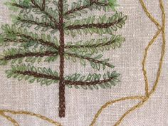I love the idea of a mini embroidered pine forest! And axe's!