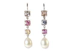 earring with nature colored saphires and south sea pearl