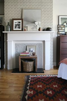 """Design*Sponge Sneak Peek: """"wallpapered"""" this fireplace wall using a curtain dipped in liquid starch. It's a great solution for renters because it will peel of completely clean when I decide to change it or move out. I love this pattern because it's geometric yet subtle and not indicative of any particular period or style."""
