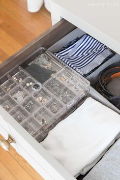 The perfect idea for storing earrings, rings, and other jewelry - acrylic stacked organizers! #organization #organizing #drawers #jewelry
