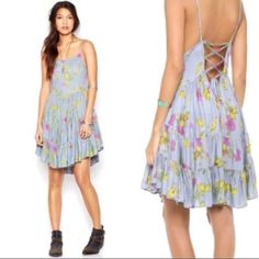 Free people CIRCLE OF FLOWERS dress Free people dress 'circle of flowers'. Blue/Grey with colorful floral design. Size Large. Laces up the back. New with tags. Free People Dresses