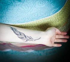 13 feather tattoo on wrist