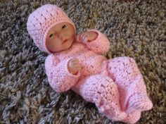 This pattern is for a sleepsuit, hat and booties set. The set is made in DK/ 3 light yarn and a size 4mm/ G crochet hook. I have included a conversion chart with the pattern for threads, stitches and hooks    The pattern is in a PDF format and will be emailed upon receipt of payment.    The pattern may be used to make the outfit but cannot be copied.    Please feel free to contact me with any questions before purchasing. Thanks