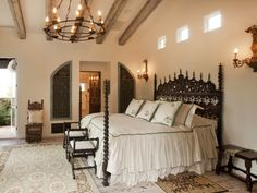 beautiful detailed 4 pstr. bed, detailed ceiling w/beams, ceiling & wall mounted lighting, furniture at ft. of bed
