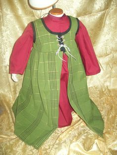 For Emery. Christmas Green Plaid over dress with gold threads size 2T.