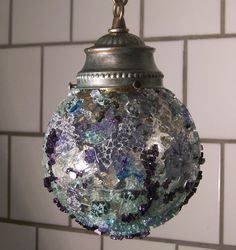 The Ice orb was created from an cast off light pendent and auto glass from 5 different junked cars. Some of the glass i use is hand dyed. Sun Cured