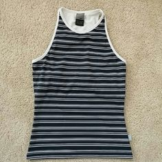 "Nike Dri Fit athletic top Nike Dri Fit athletic top. Navy and white strip. Sleeveless, racerback. Build in bra/support. 19.5"" shoulder to hem. I used this for tennis. Excellent used condition. 88 polyester 12 spandex. Size S (4-6). Matching skirt in separate listing. Nike Tops"