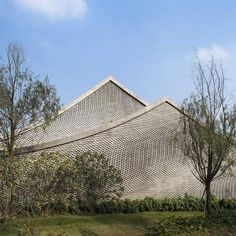 Archi-Union used bricks to make waves on the walls of this restaurant and members' club at a cultural heritage park in Chengdu, China.