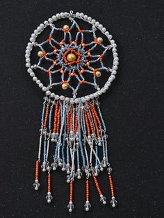 Tada! This orange and blue beaded dream catcher is finally finished!