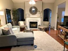 Collonade Gray in a living room with marble fireplace and arched doorways. Kylie M Interiors E-design Warm Gray Paint, Best Gray Paint Color, Greige Paint Colors, Paint Colours, Paint Colors For Living Room, Paint Colors For Home, Living Room Grey, Farmhouse Paint Colors, Marble Fireplaces