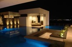 View from the living area of the pool and Las Vegas valley lights. - New American Home 2013