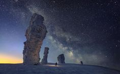 """The Milky Way over the Seven Strong Men Rock Formations Image Credit & Copyright: Sergei Makurin. high pillars """"Seven Strong Men"""" located just west of the Ural Mountains, the unusual Manpupuner rock formations of Russia. Komi Republic, Ural Mountains, Astronomy Pictures, Reserva Natural, Seven Wonders, Image Of The Day, To Infinity And Beyond, Rock Formations, Milky Way"""