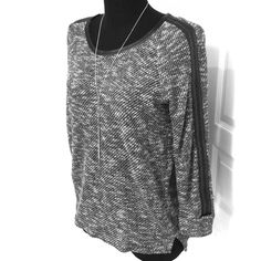 LIKE NEW!Vince Camuto Top This top has only been worn once and is in like new perfect condition. It has leather like trim around the neck and down the sleeves. The fabric content is 76% cotton and 24% polyester. The top is a size small but could definitely fit a medium. Vince Camuto Tops Sweatshirts & Hoodies