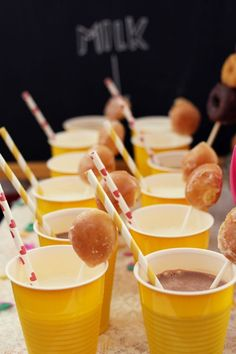 loving on the donut and milk theme… donut hole lollypops with chocolate milk… yes please!
