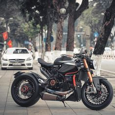 """""""Modern racer? Cafe fighter? One thing is for certain, this Ducati Panigale by @gabeofuktory of Vietnam is is one menacing beast of a bike. #croig…"""""""