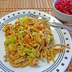 Chicken Cashew Casserole--10 3/4 oz. can condensed cream of chicken soup  1/4 cup water  2 cups cooked cubed chicken  1/2 cup coarsely chopped cashews  2 stalks celery, chopped (fairly large pieces)  1 small onion, chopped  2 cups chow mein noodles  1 teaspoon Chinese Five Spice