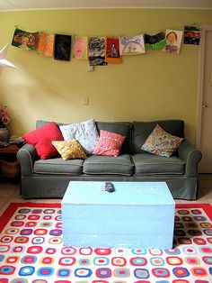 The boys lounge. wicked. love that rug and the art work. Mismatched cushions work for me.