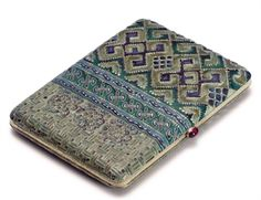 A SILVER-GILT AND CLOISONNÉ ENAMEL CIGARETTE CASE  MARKED FABERGÉ WITH THE IMPERIAL WARRANT, MOSCOW, 1908-1917