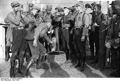 Nazi Party SA men drinking water during a break in their training, Niederbarnim, Brandenburg, Germany, 1932