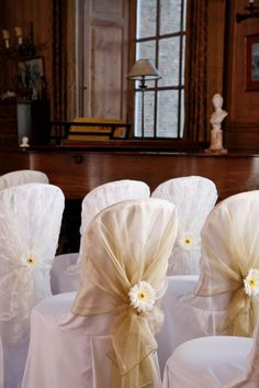 Wedding chair covers @Tale of Two Wedding Coordination - sans the white chair cover. Just the white/off-white tulle wrapped around the back-rest of the chair?