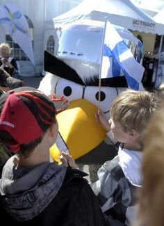 HockeyBird, the ocfficial mascot of the World Championships, poses with children ahead of the Group H game Belarus vs France in the 2012 IIHF Ice Hockey World Championships in Helsinki, Finland, on May 14, 2012.