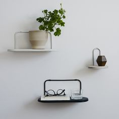Skagerak's clean-lined Wire shelf is perfect for displaying your favourite books, houseplants and small decor items. Designed by Martin Solem, Wire consists of an oval ash shelf and a rounded steel frame.