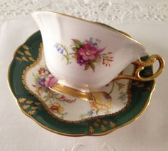Vintage E.B Foley china tea cup and saucer, made in England. A beautiful duo in green with a floral centre on both cup and saucer. It is in good condition, no chips, cracks, crazing or repairs and both pieces ring nicely Please Note: The items I sell are not new, they are
