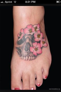 Foot Tattoo with different flowers