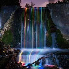 Shot Of Glow Sticks Dropped Into A Waterfall