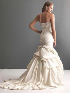 "Strapless, Taffeta Fit N Flare Wedding Gown Showcasing A Swarovski Crystal Embellished Sweetheart Neckline, Corset Bodice, & A Unique ""Bustled"" Skirt With Light Pick-Ups; by Allure Bridals Romance"