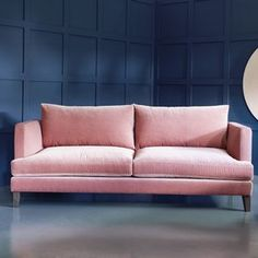 Marlon Modern Sofa. Beige and brown, be gone! Pink upholstery is the perfect breath of fresh air to update your living space. This rose-toned velvet sofa deserves pride of place in the home of any modern princess.