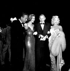"Humphrey Bogart, Lauren Bacall, screenwriter Nunally Johnson, and Marilyn Monroe at the premiere of ""How To Marry A Millionaire""/"