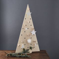 Christmas tree Pegboard - made from birch plywood it comes with a selection of pegs to hang decorations on the tree!