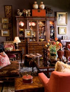 Absolutely stunning....one of my favorite pins EVER. The dark walls are fabulous, paired with the warm upholstery colors and rich layering.