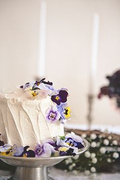 Vanilla cake topped with edible violas   Photo by Bit of Ivory   Styling by Healthfully Ever After