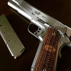 Kimber's Stainless Raptor II, a full-size 1911 with frame serrations unique to the Raptor model family; zebra wood scale pattern grips with Kimber logo. M&p 9mm, Kimber 1911, Combat Gear, Guns And Ammo, Firearms, Hand Guns, Pure Products, Pistols, Knives