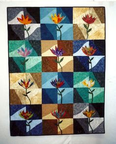 Leaves & Vines 3  This is the third in a series of 3 quilts.  I used fabrics that I died myself and some commercials.  I love the progression of the colors.  It has been exhibited in three shows.