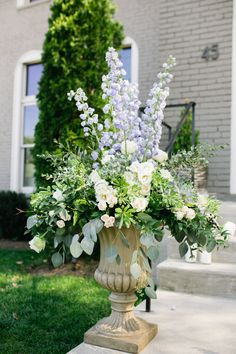 Luxe floral arrangements - tall with delphinium blue. Venue: The Cordelle. Planning: Randi Events. Photography: SheHeWe Photography. Florals: Enchanted Florist TN
