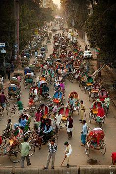 Rickshaw traffic jam, Dhaka, Bangladesh/streets look like this, except narrower, darker Sri Lanka, Nepal, Laos, Vietnam, Brunei, Bangladesh Travel, Dhaka Bangladesh, Places Around The World, Around The Worlds