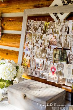 idea for displaying family photos from other weddings at the guest book table.