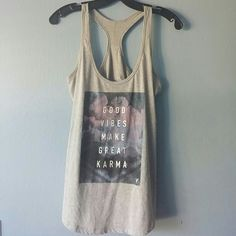 Old Navy Active Karma Tank Good Vibes Make Great Karma! Only worn a couple of times. Semi-fitted. Piling as you can see in the pictures but I think it came that way. Very comfy! Old Navy Tops Tank Tops