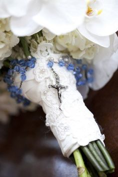 A Rosary wrapped around the stem of your bouquet... I wish I thought of this.